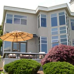 In this undated photo provided by the King County Dept. of Assessments, the $1.2 million waterfront home where prosecutors say a Seattle chiropractor and his wife lived while claiming welfare assistance is seen.