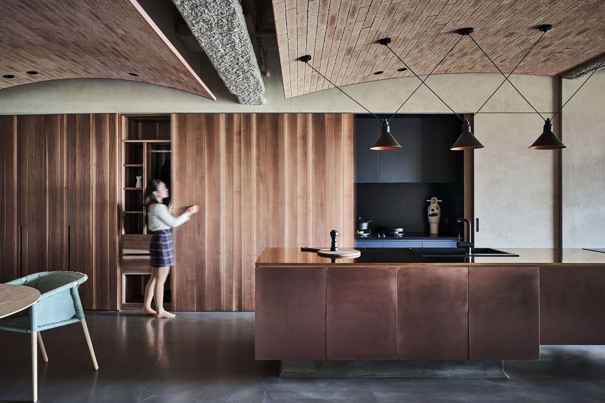 Moody Apartment Renovation Is All About Natural Materials
