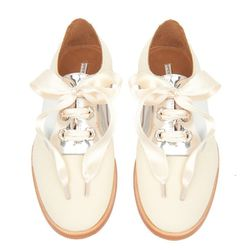 """<b>Opening Ceremony</b> Contrasting Lace-Up Oxfords in off white/silver, <a href=""""http://www.openingceremony.us/products.asp?menuid=2&catid=16&subcatid=63&designerid=6&productid=75406"""">$395</a>"""