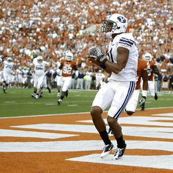 Wide receiver Ross Apo #11 of the BYU Cougars catches a second quarter touchdown pass by Jake Heaps against the Texas Longhorns on September 10, 2011 at Darrell K. Royal-Texas Memorial Stadium in Austin, Texas.  (Photo by Erich Schlegel/Getty Images)