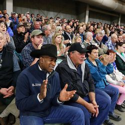KC Carden, front, applauds during a town hall meeting at the Salt Lake County Equestrian Park in South Jordan, Monday, April 25, 2016.