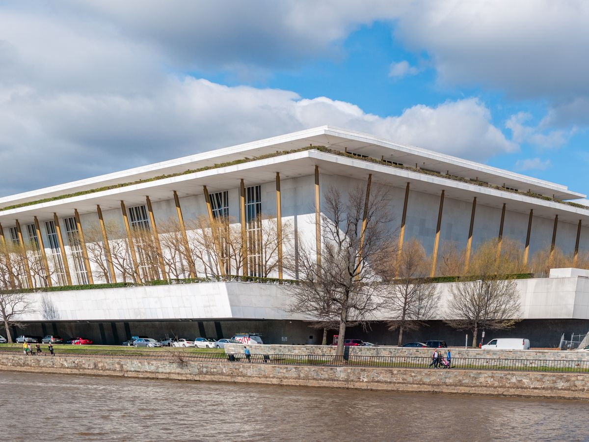 The exterior of the John F Kennedy Center for the Performing Arts. The facade is white.