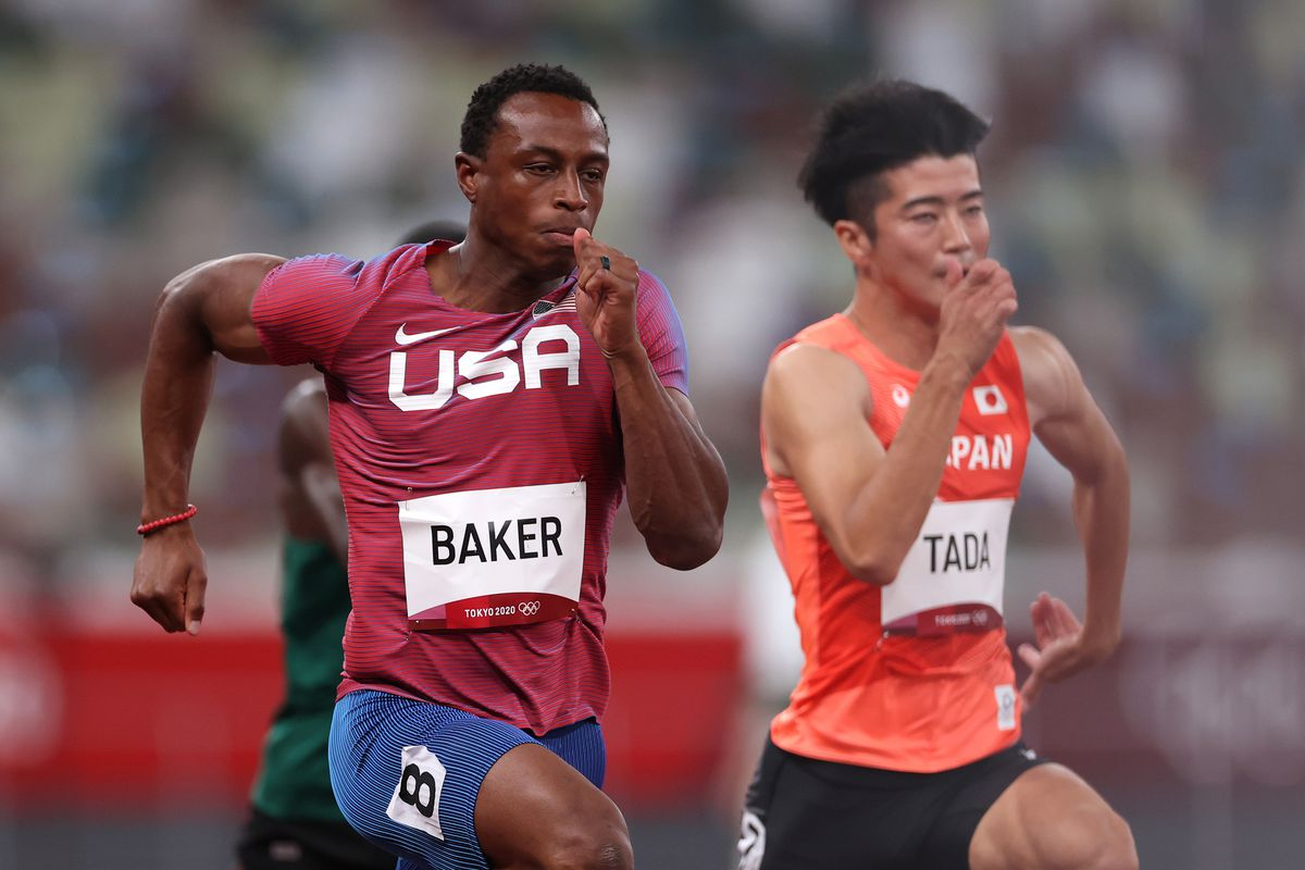 Ronnie Baker of Team United States and Shuhei Tada of Team Japan compete in the Men's 100m Round 1 heats on day eight of the Tokyo 2020 Olympic Games at Olympic Stadium on July 31, 2021 in Tokyo, Japan.
