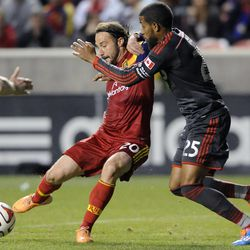 Real Salt Lake midfielder Ned Grabavoy (20) kicks the ball past the defense of Toronto FC defender Jeremy Hall (25) during a game at Rio Tinto Stadium in Sandy on Saturday, March 29, 2014.