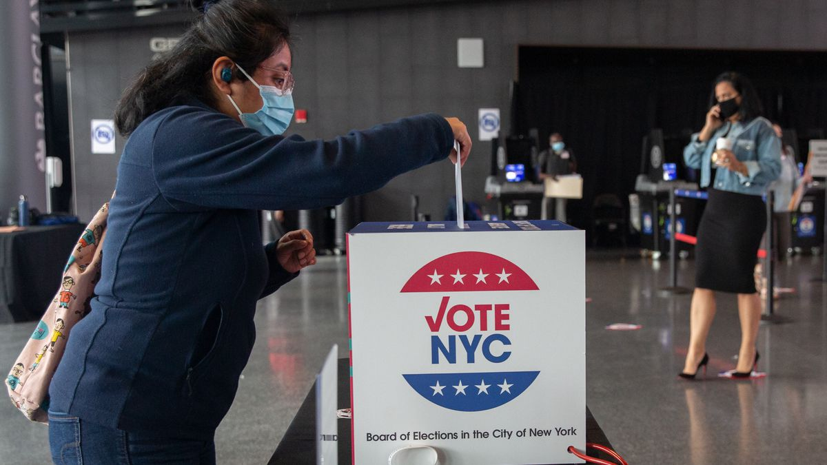 A Brooklyn resident drops off an absentee ballot at the Barclays Center on the first day of early voting, Oct. 24, 2020.