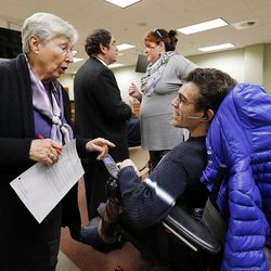 Rosemary Young, a House secretary, talks with public advocate Andrew Riggle of the Utah Disability Law Center before a House Judiciary Committee meeting at the Capitol in Salt Lake City on Wednesday, Feb. 3, 2016. Riggle spoke concerning HB101, a bill that would eliminate the requirement that some wards be represented by an attorney in guardianship proceedings.