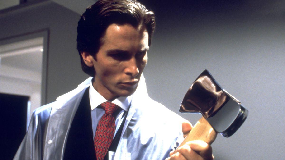Patrick Bateman (Bale) holds onto an axe.
