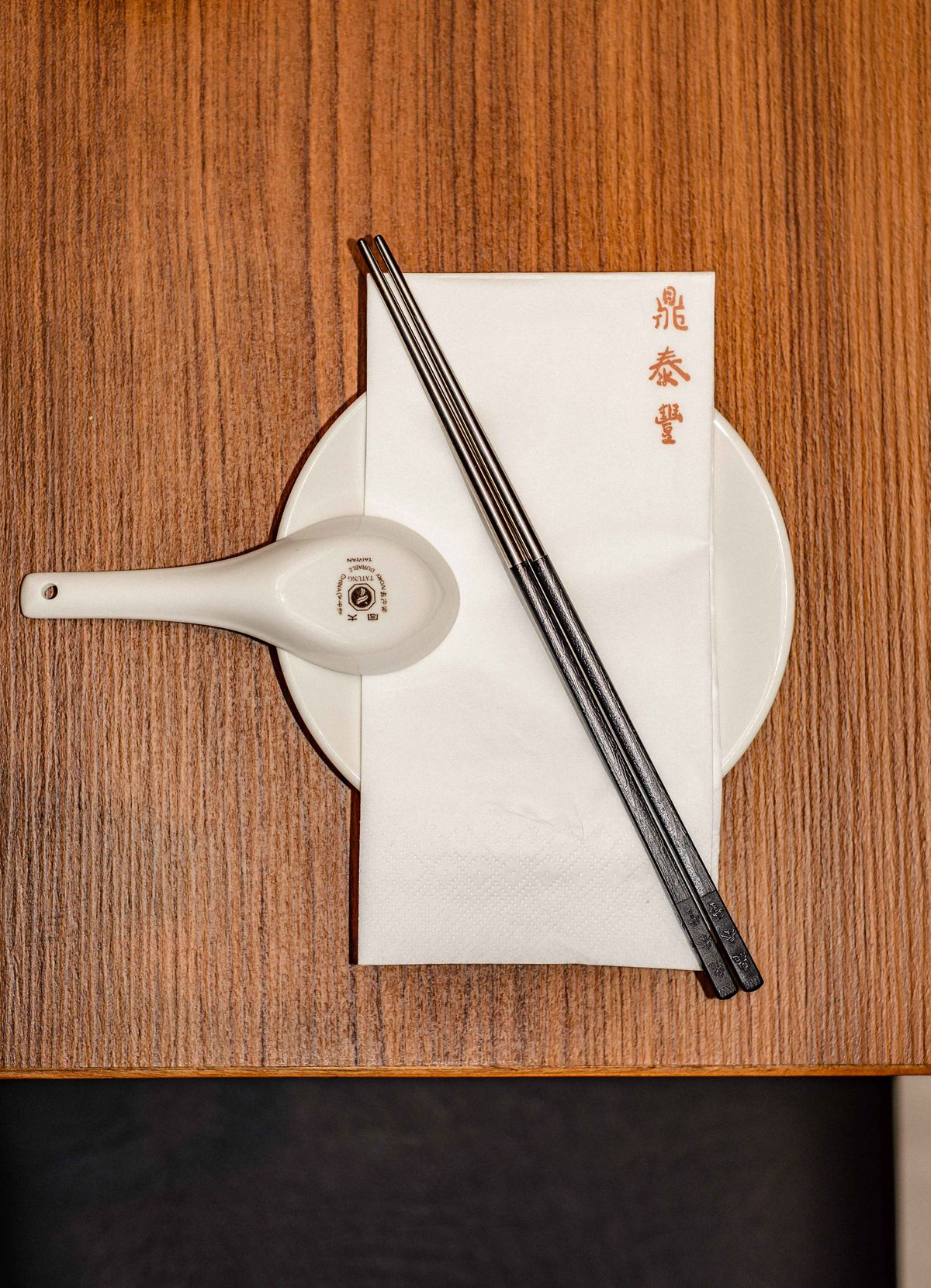 Chopsticks, soup spoon and napkin for xiaolongbao dumplings at Din Tai Fung's new London restaurant in Covent Garden