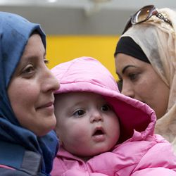 """Syrian refugees smile upon their arrival at Rome's Fiumicino international airport, Monday, Feb. 29, 2016. They landed  at Rome's Leonardo Da Vinci airport thanks to the """"humanitarian corridor"""" project launched by the Rome-based Catholic Sant'Egidio Community and the Federation of Protestant Churches in Italy. Speaking to people in St. Peter's Square Sunday, Pope Francis said a """"concerted response can be more effective and distribute equally the weight"""" of helping the migrants. (AP Photo/Alessandra Tarantino)"""