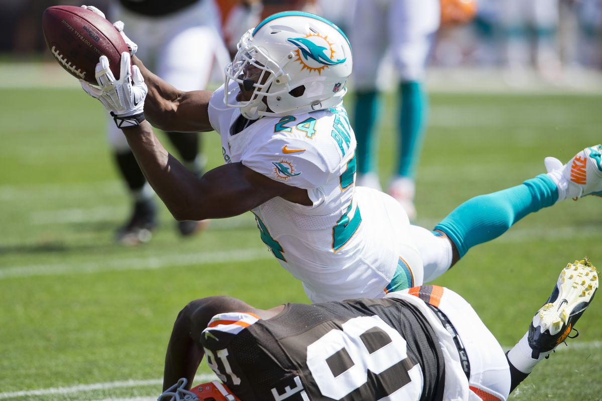 Dimitri Patterson mimics his helmet during one of his two interceptions against the Cleveland Browns.