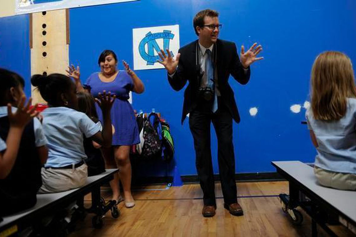 James Cryan, founder of Rocky Mountain Prep, leads students and staff in a cheer in 2012.