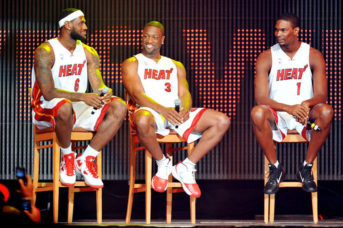 MIAMI - JULY 09:   LeBron James #6 Dwyane Wade #3 and Chris Bosh #1 of the Miami Heat speak after being introduced to fans during a welcome party at American Airlines Arena on July 9 2010 in Miami Florida.  (Photo by Doug Benc/Getty Images)