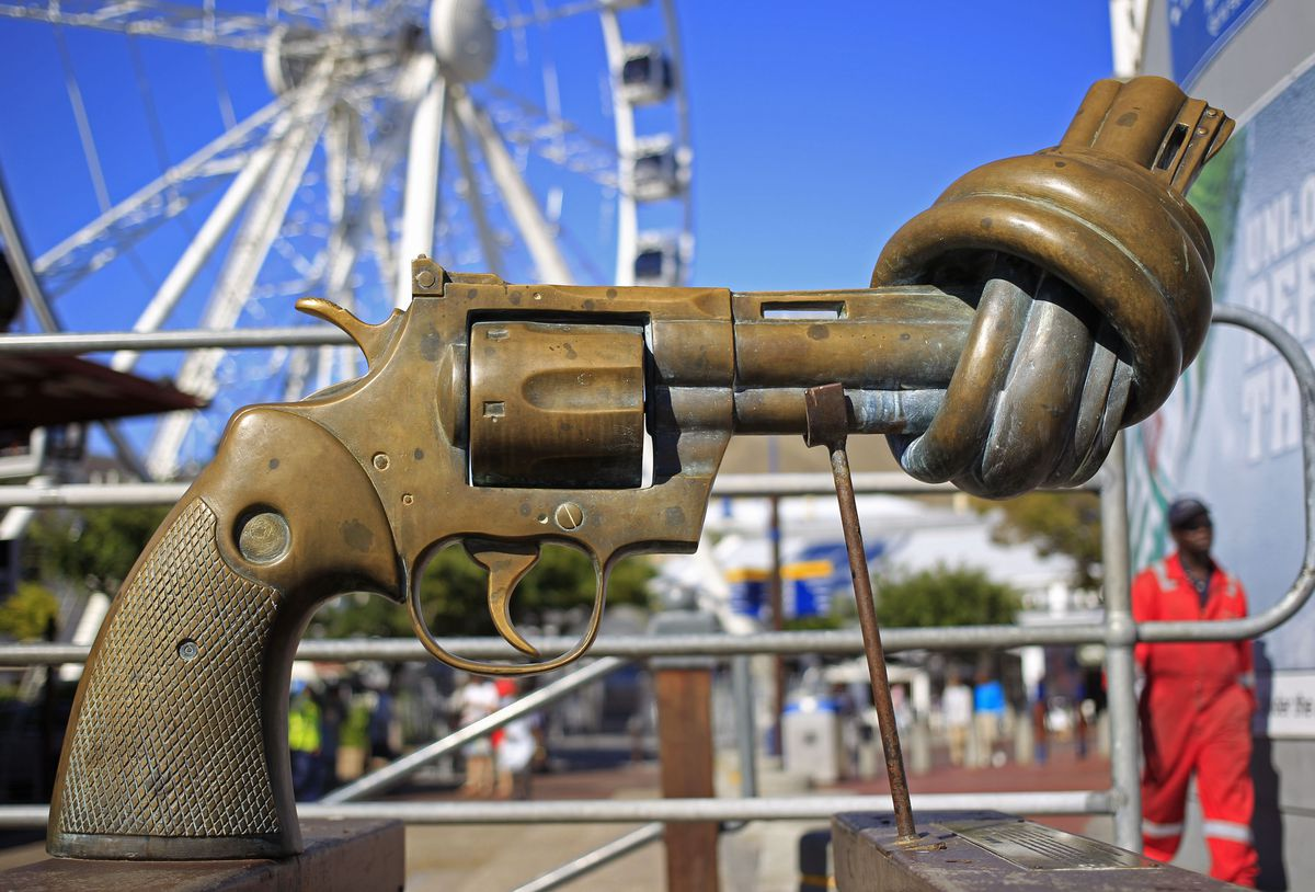 """In this Feb. 26, 2013 photo, a sculpture by Carl Fredrik Reutersward, titled """"knotted gun"""" is displayed in Cape Town, South Africa. AP file photo"""