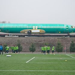Boeing Plane Transported Behind Warmup Drill