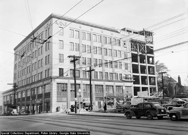 The exterior of the Life of Georgia Building. The building is white with multiple windows.