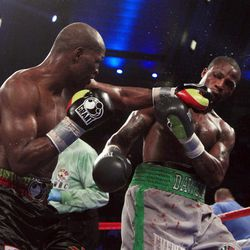 Bernard Hopkins, left, hits Chad Dawson with a punch in the 11th round of their  light heavyweight boxing match in Atlantic City, N.J., Saturday, April 28, 2012. Dawson won a majority decision.