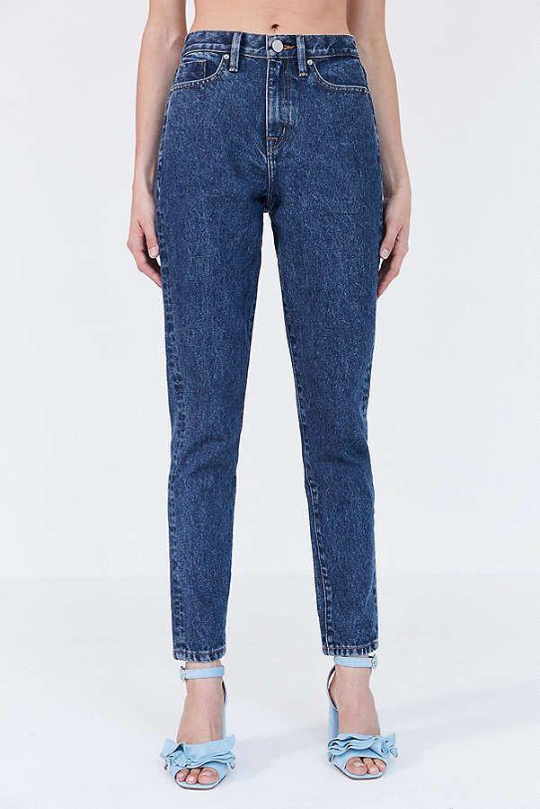 A pair of high rise dark denim jeans