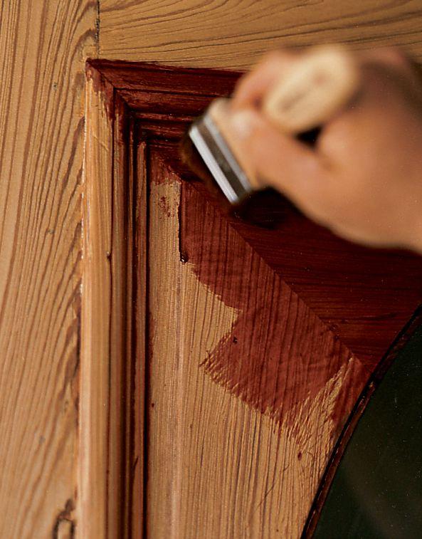 Man Applies Finish To Door
