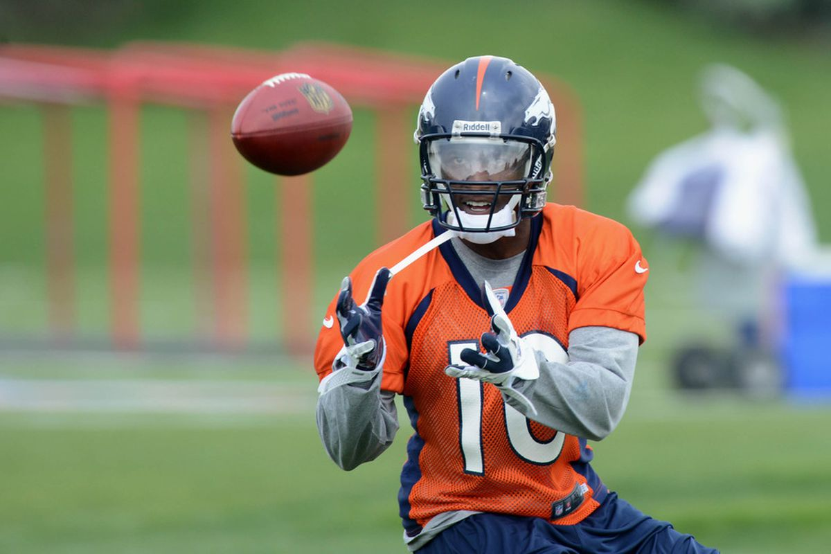 May 13 2012; Englewood, CO, USA; Denver Broncos wide receiver Gerell Robinson (10) prepares to catch a pass during mini camp at Broncos headquarters. Mandatory Credit: Ron Chenoy-US PRESSWIRE