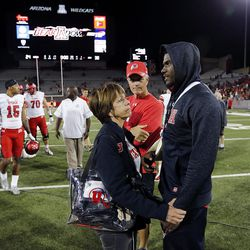 Helen Livingston talks with Utah Utes quarterback Tyler Huntley following an NCAA football against Arizona in Tucson, Arizona, on Friday, Sept. 22, 2017. Huntley was injured in the first half of the game.