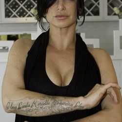 The strongest women in Pellegrino's family cover her forearm, and a cooking burn.