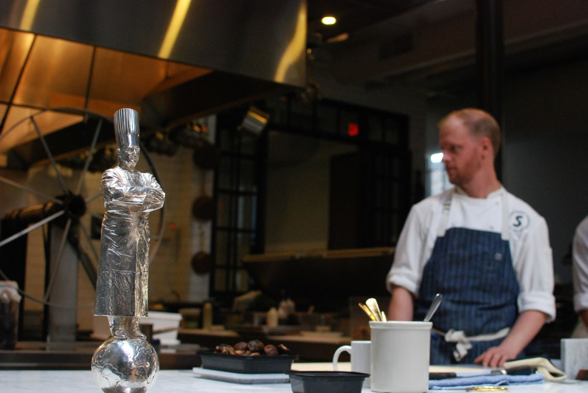 The trophy and chef Chris Nye inside the kitchen at Spoon & Stable