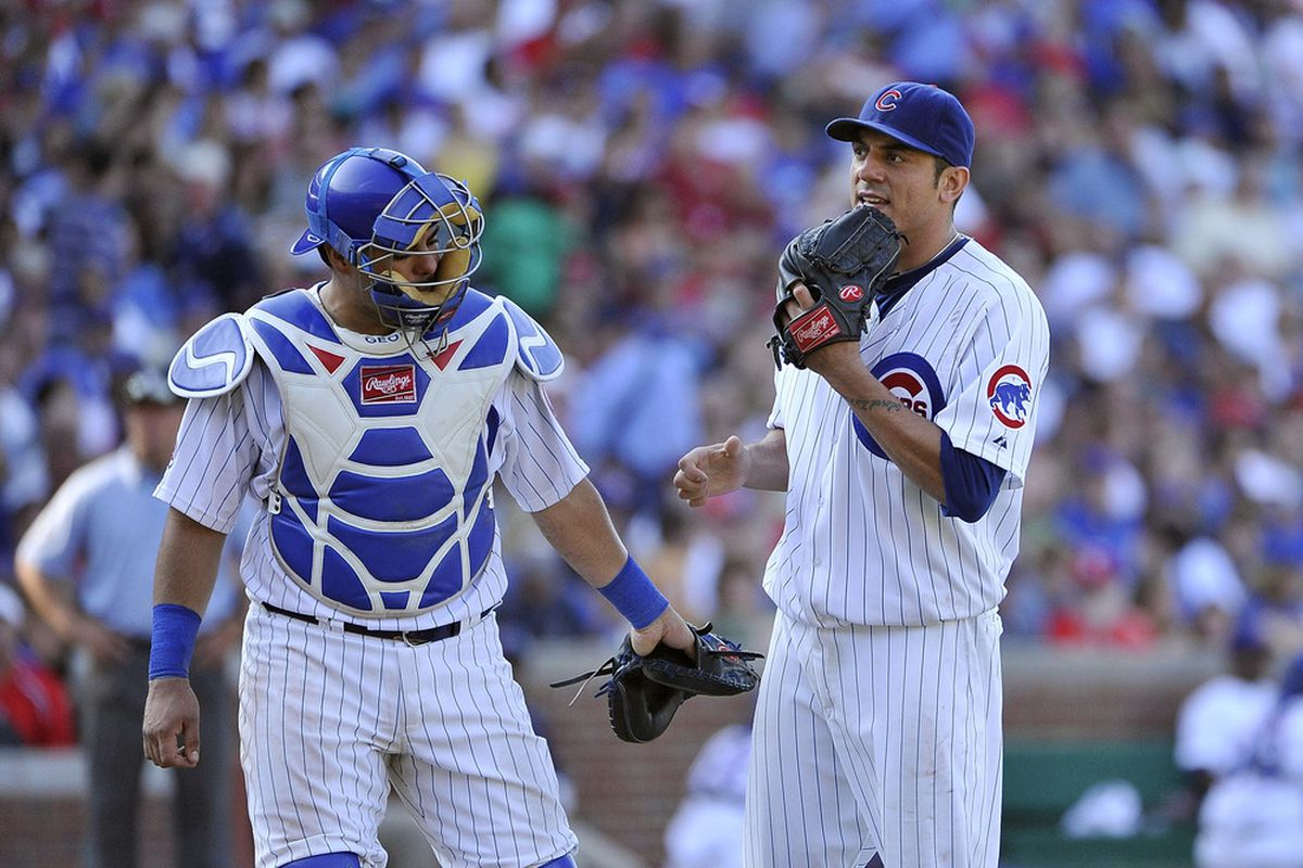 Catcher Geovany Soto of the Chicago Cubs talks with pitcher Matt Garza during the 7th inning against the St. Louis Cardinals at Wrigley Field in Chicago, Illinois. The Cubs defeated the Cardinals 3-0.  (Photo by Brian Kersey/Getty Images)