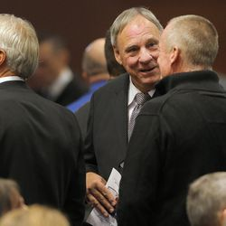 Former quarterback Gary Sheide talks with old friends and teammates  at the memorial for former BYU football coach Lavell Edwards at the Provo Convention Center on Friday, Jan. 6, 2017.