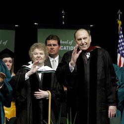President Thomas S. Monson and his wife, Sister Frances J. Monson, wave to the audience after they received honorary degrees at Utah Valley University's commencement Friday.