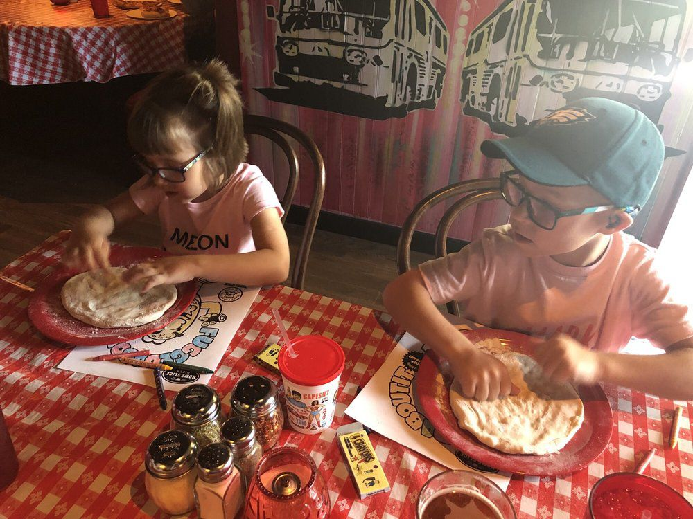 Kids playing with dough at Home Slice