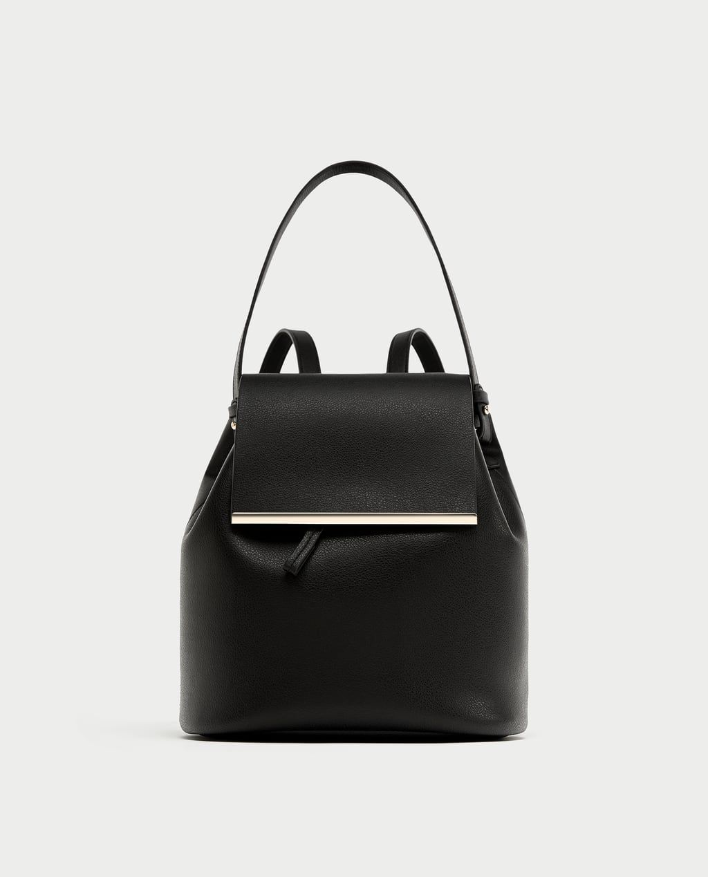 A black faux leather backpack
