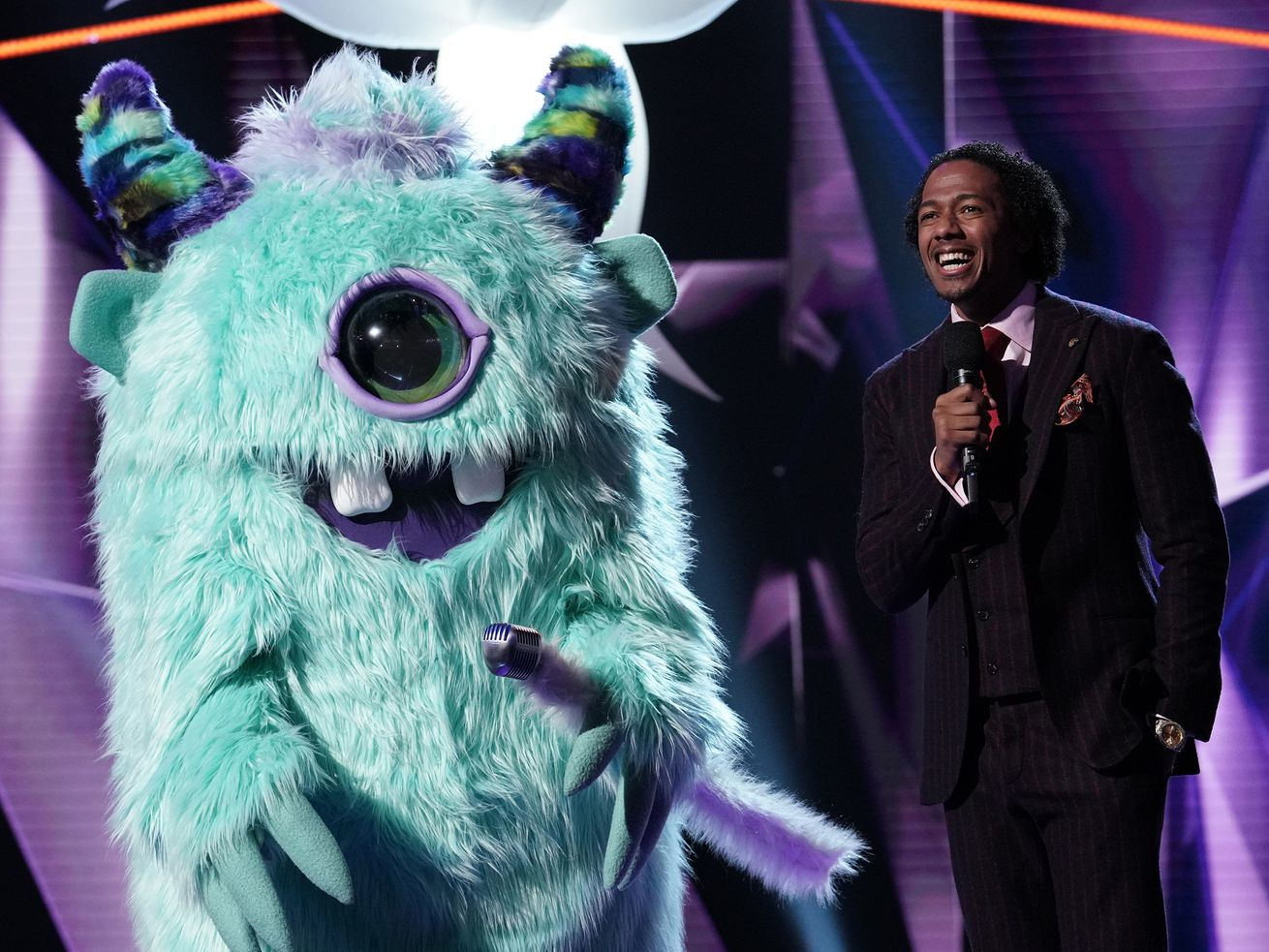 """The Monster hangs out with host Nick Cannon. I was going to put a (left) after """"The Monster"""" but figured you would get the picture."""