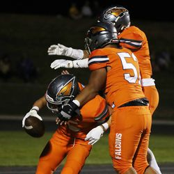 Skyridge's Collin Sheffield (5) celebrates his sack and fumble recovery for a touchdown in Lehi on Thursday, Aug. 12, 2021.