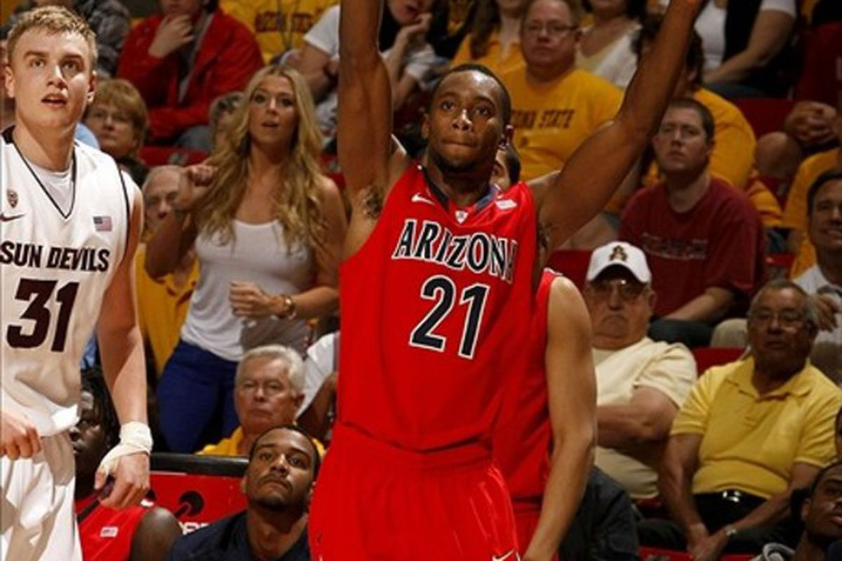 March 4, 2012; Tempe, AZ, USA; Arizona Wildcats guard Kyle Fogg (21) reacts after making a basket against the Arizona State Sun Devils in the second half at Wells Fargo.  Mandatory Credit: Rick Scuteri-US PRESSWIRE