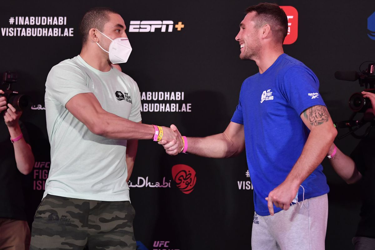Opponents Robert Whittaker of New Zealand and Darren Till of England face off during the UFC Fight Night weigh-in inside Flash Forum on UFC Fight Island on July 24, 2020 in Yas Island, Abu Dhabi, United Arab Emirates.