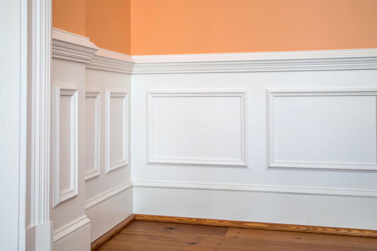 Wainscoting and chair rail on wall of dining living room.