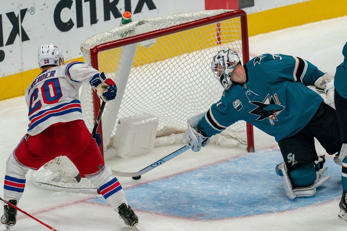 Oct 30, 2018; San Jose, CA, USA; New York Rangers left wing Chris Kreider (20) scores during the third period against San Jose Sharks goaltender Aaron Dell (30) during the third period at SAP Center at San Jose.