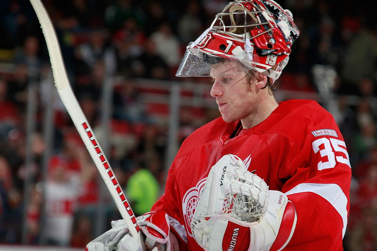 DETROIT, MI - OCTOBER 28: Jimmy Howard #35 of the Detroit Red Wings looks on while playing the San Jose Sharks at Joe Louis Arena on October 28, 2011 in Detroit, Michigan. San Jose won the game 4-2. (Photo by Gregory Shamus/Getty Images)