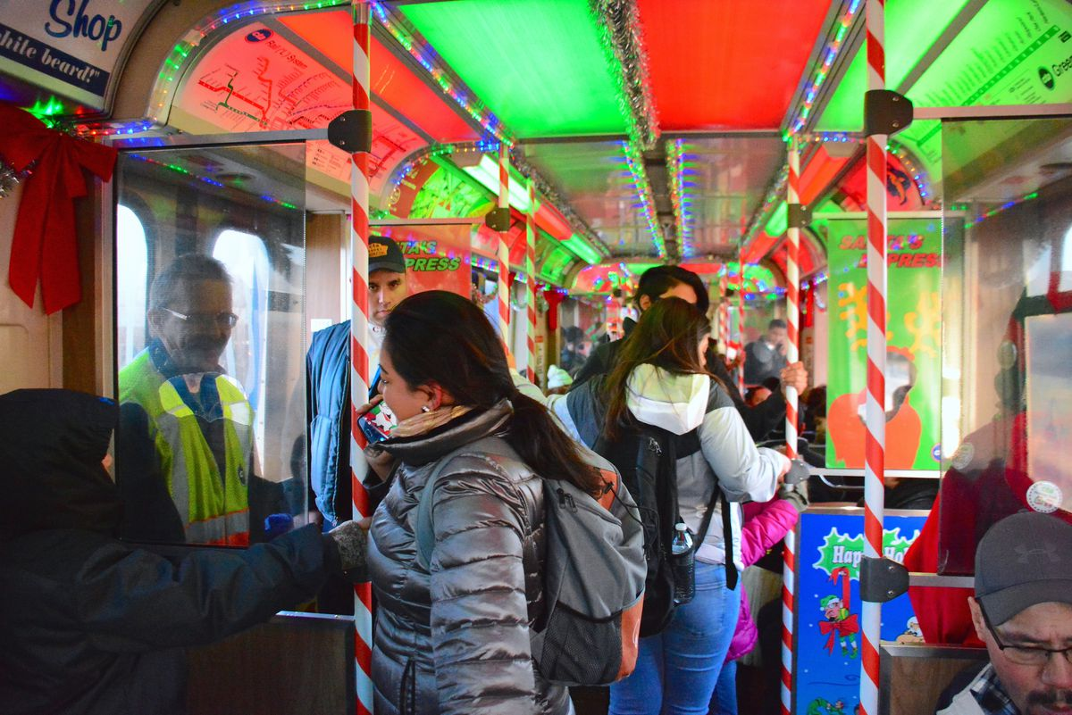 The interior of an L car with holiday decor.
