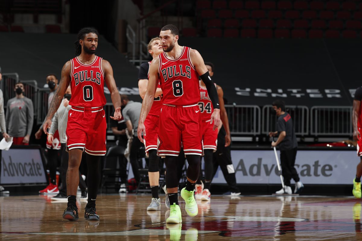 Coby White and Zach LaVine of the Chicago Bulls talk during the game against the Cleveland Cavaliers on March 24, 2021 at United Center in Chicago, Illinois.