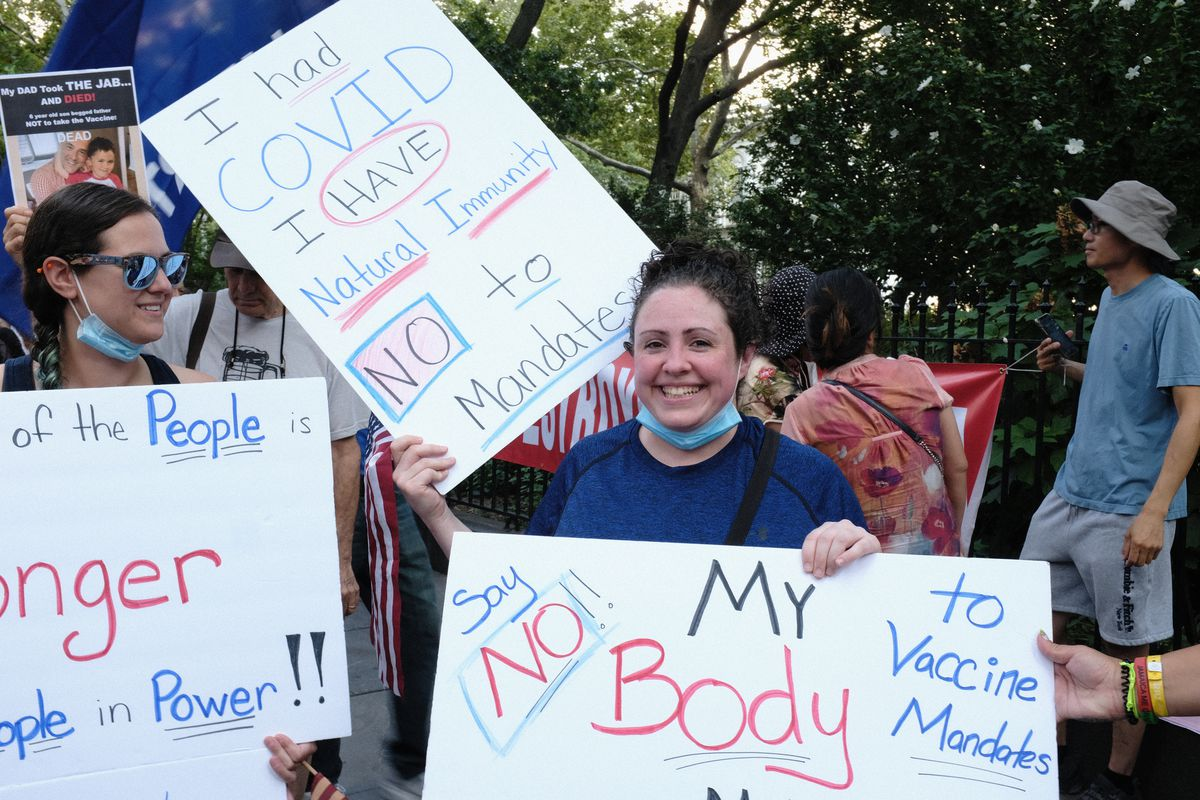 Erin Barra, a special-education teacher from Staten Island, said she lost her mother to COVID-19 and was sickened by the virus. She joined protesters at City Hall Wednesday, Aug. 25, 2021.