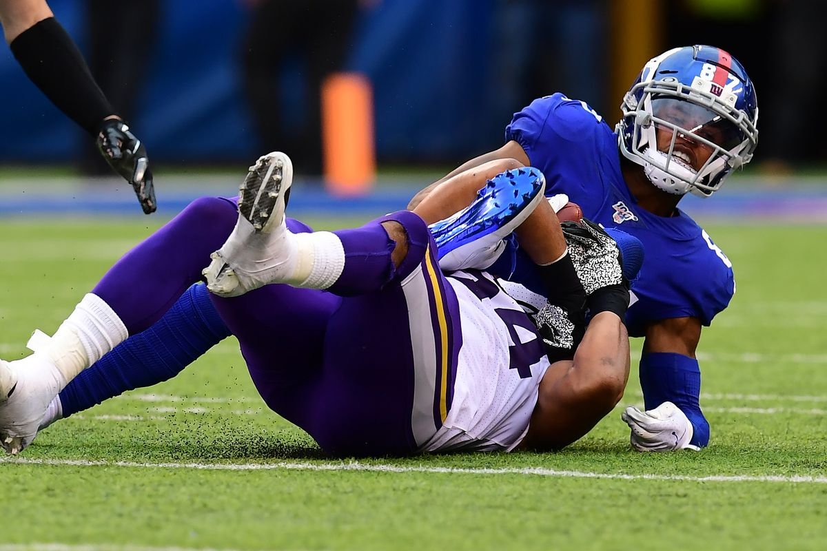 Eric Kendricks of the Minnesota Vikings tackles Sterling Shepard of the New York Giants during their game at MetLife Stadium on October 06, 2019 in East Rutherford, New Jersey.