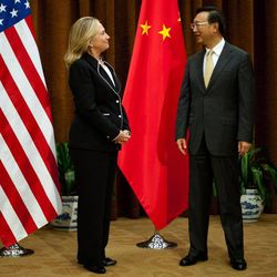 U.S. Secretary of State Hillary Rodham Clinton, left, talks with Chinese Foreign Minister Yang Jiechi, at the Ministry of Foreign Affairs in Beijing Tuesday, Sept. 4, 2012.  Clinton is in Beijing to press Chinese authorities to agree to peacefully resolve disputes with their smaller neighbors over competing territorial claims in the South China Sea.