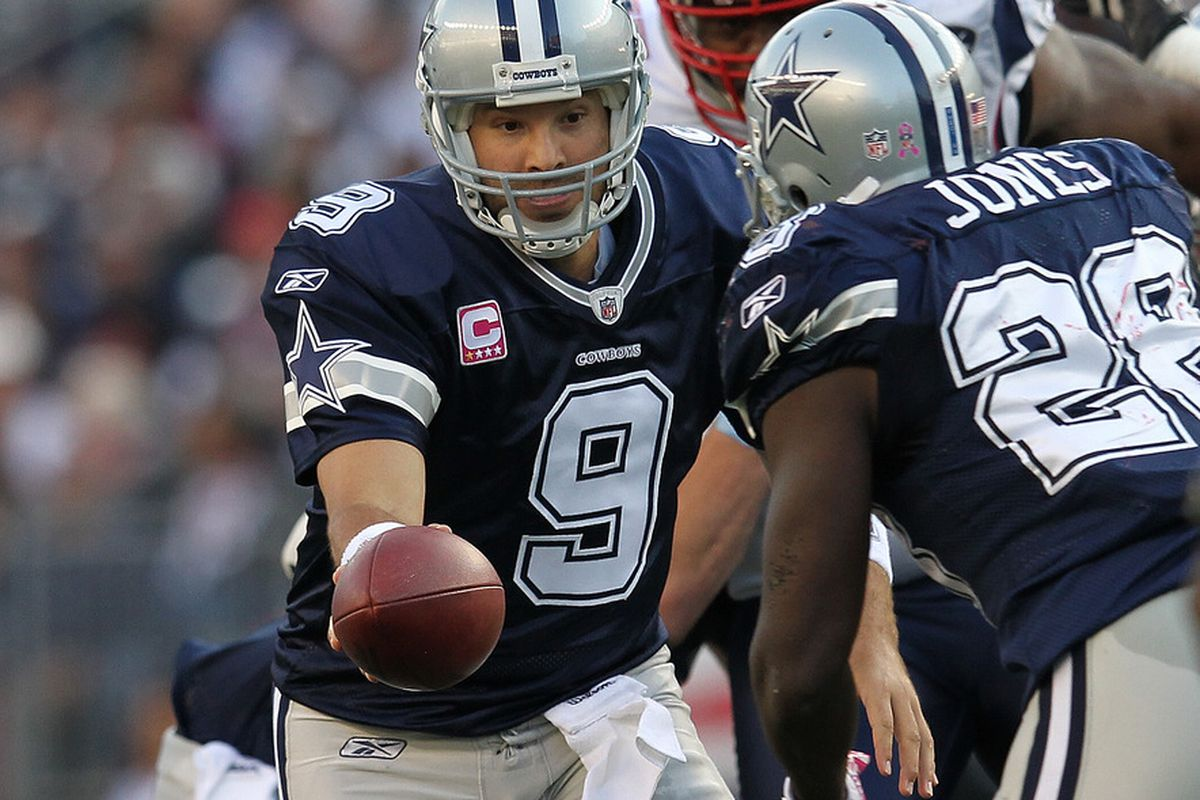 Tony Romo (9) of the Dallas Cowboys hands the ball to Felix Jones (28) of the Dallas Cowboys against the New England Patriots in the second half at Gillette Stadium on October 16, 2011 in Foxboro, Massachusetts. (Photo by Jim Rogash/Getty Images)