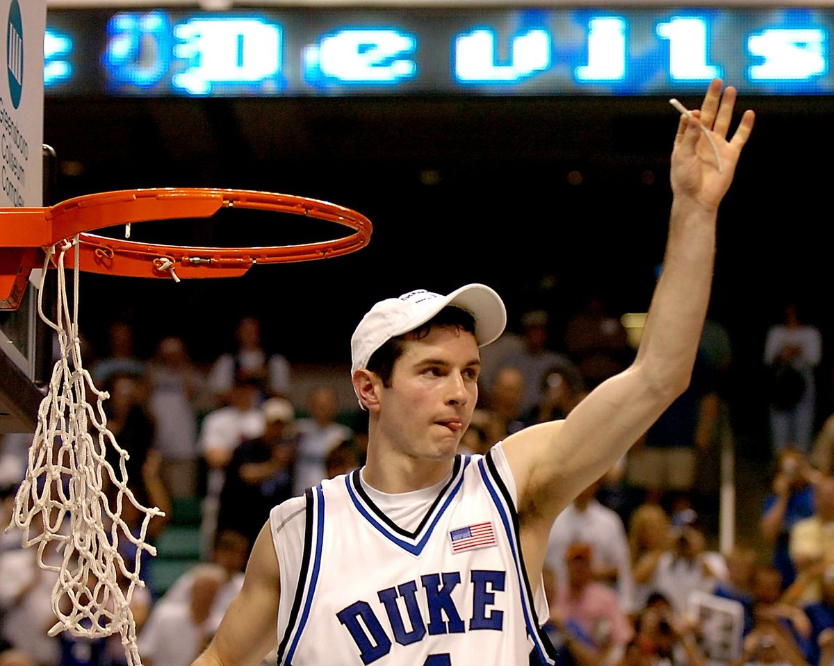 Duke's J.J. Redick shows of a section of the cut net as his