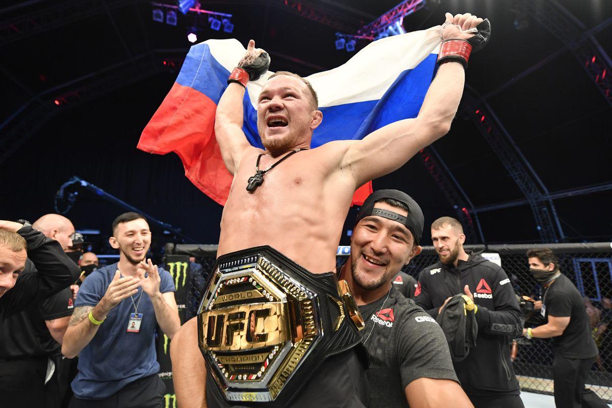 Petr Yan celebrates his UFC title winning victory over Jose Aldo.