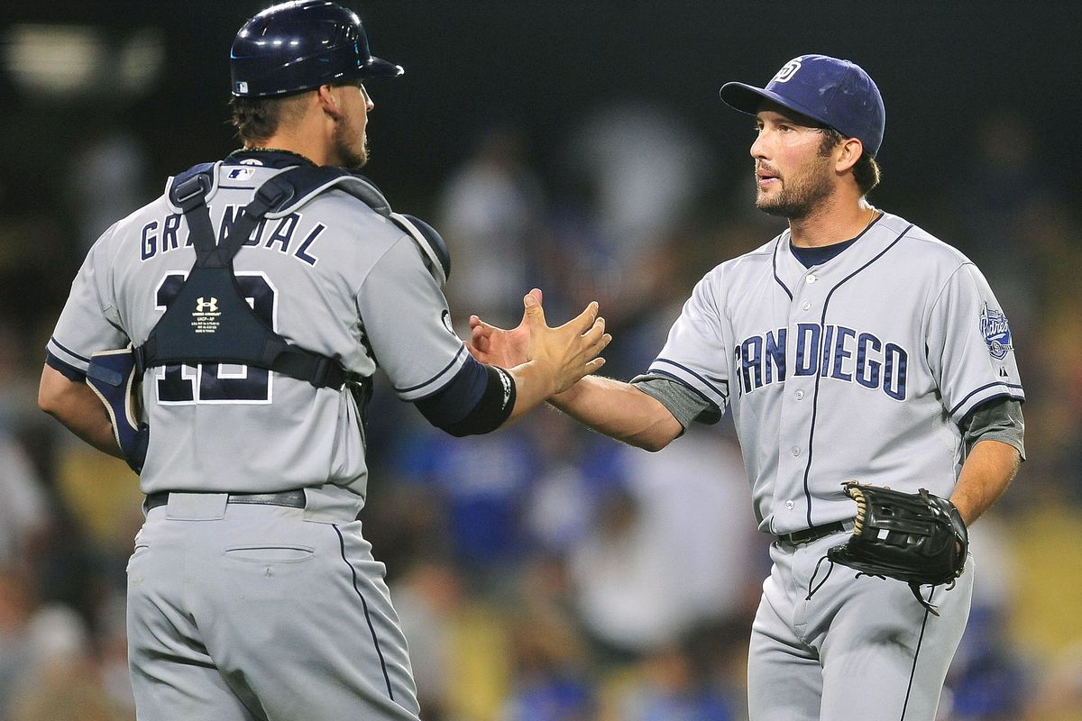 July 14, 2012; Los Angeles, CA, USA; San Diego Padres relief pitcher Huston Street (16) and catcher Yasmani Grandal (12) celebrate their 7-6 victory against the Los Angeles Dodgers at Dodger Stadium. Mandatory Credit: Gary A. Vasquez-US PRESSWIRE