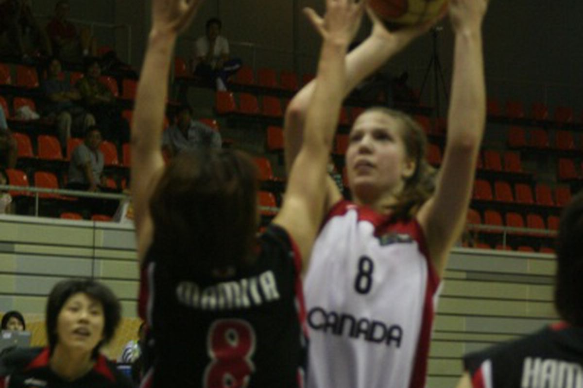 Michelle Plouffe shoots for two of her team 14 against Japan (Courtesy of FIBA)