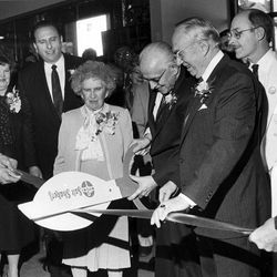 LDS Church President Ezra Taft Benson cuts ribbon with wife, Flora, at his side. Standing to the left are President Thomas S. Monson and his wife Frances; at right are President Gordon B. Hinckley and his wife, Marjorie. Oct. 26, 1986.