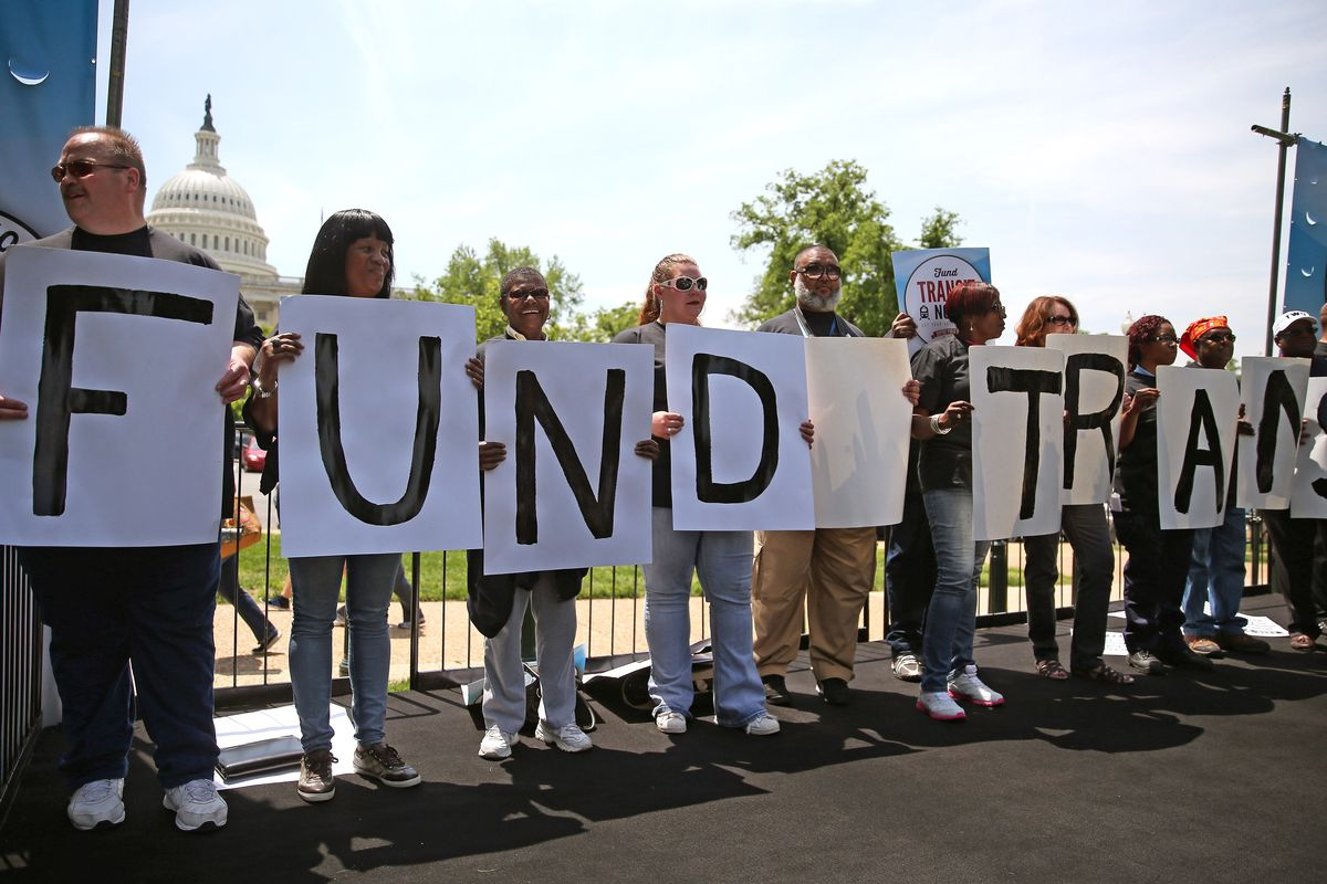 Transit workers participate in a rally to urge Congress to replenish the Highway Trust Fund, on Capitol Hill, May 20, 2014 in Washington, DC.